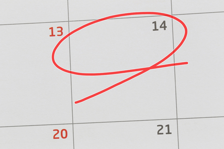 Focus on number 14 in calendar and empty red ellipse for design in your ideas and work concept.
