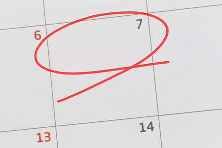 Focus on number 7 in calendar and empty red ellipse for design in your ideas and work concept.