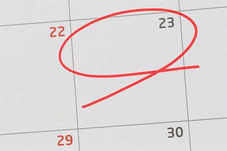 Focus on number 23 in calendar and empty red ellipse for design in your ideas and work concept.