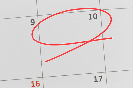 Focus on number 10 in calendar and empty red ellipse for design in your ideas and work concept.
