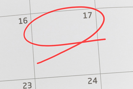 Focus on number 17 in calendar and empty red ellipse for design in your ideas and work concept. 版權商用圖片