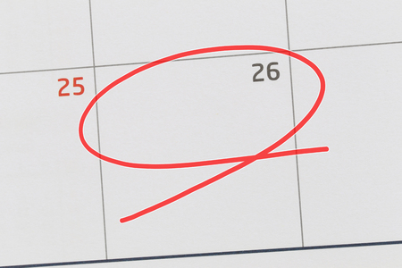 Focus on number 26 in calendar and empty red ellipse for design in your ideas and work concept.