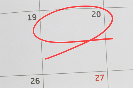 Focus on number 20 in calendar and empty red ellipse for design in your ideas and work concept.