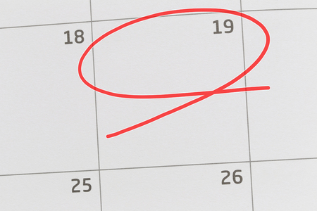 Focus on number 19 in calendar and empty red ellipse for design in your ideas and work concept.