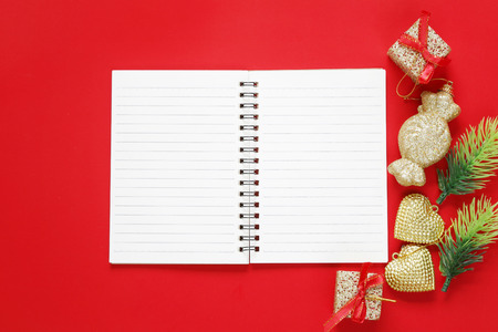 Christmas Decoration and empty notebook on red background for design in your work concept.