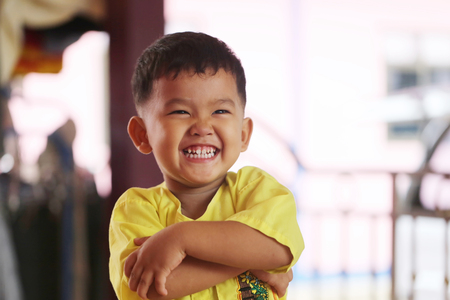asian boy smiling happily and standing with his hands crossed,Thailand boy. Stock Photo