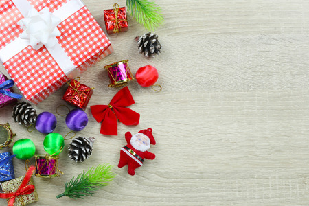 Red gift box of Equipment for Christmas decoration on wooden floor background and have copy space. Stock Photo