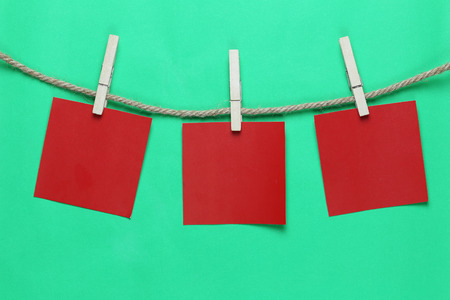 Red paper note hang on hemp rope and have copy space for design in your work concept. Stock Photo - 112312924