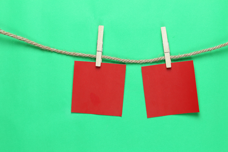 Red paper note hang on hemp rope and have copy space for design in your work concept.