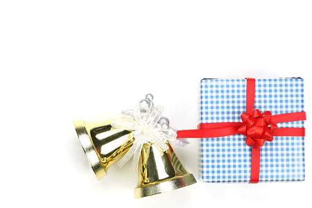 Golden Bell of christmas and blue gift box on white background and have copy space to design in your work concept.