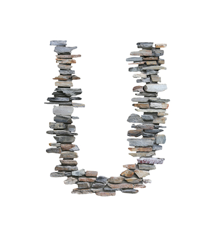Font of U to create from stone wall isolated on white background with clipping paths.