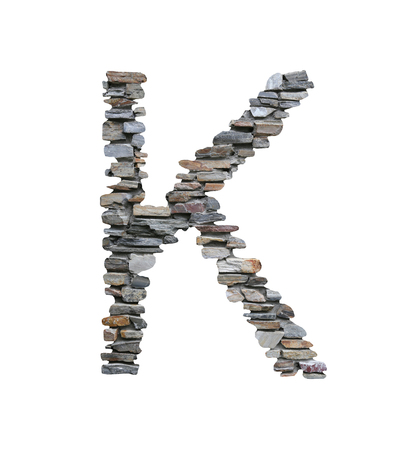 Font of K to create from stone wall isolated on white background with clipping paths.