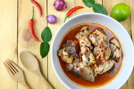 Fish curry of Eeltail catfish sea of Thai foods on wooden floor and have spices. Archivio Fotografico