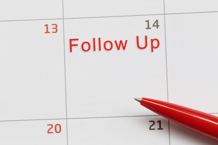 Red pen point to a empty space on the calendar and have follow up text for design in your work concept.