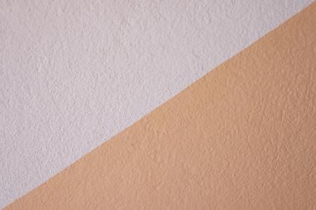 Orange Betontextur der Wand für das Design in Ihrem Arbeitshintergrundkonzept.
