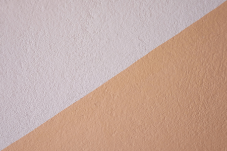 Orange concrete texture of the wall for design in your work backdrop concept.