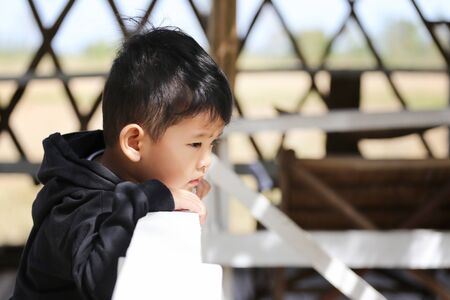 Focus on Action of Asian boy is Staring at something,Concepts of health and Learning.