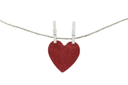 red heart hanging on a rope isolated on white background and have clipping paths.