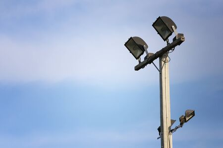 Spotlight of Lighting Pole on blue sky background and have copy space for design in your work.