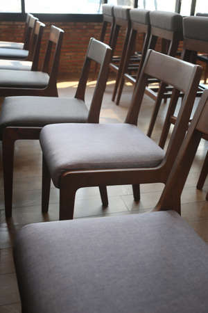 An empty chair in a coffee shop,concept of loneliness and emptiness.