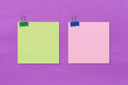 Colorful square note paper on purple paper background and have copy space for you design.