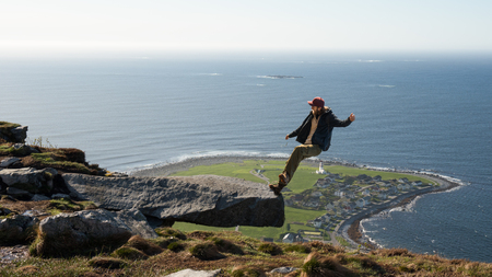 Guy falling off cliff from the mountain.