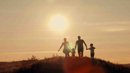 happy family at sunset silhouette of the water