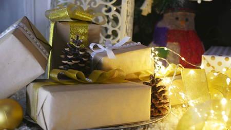 Presents under the Christmas tree on floor Stockfoto