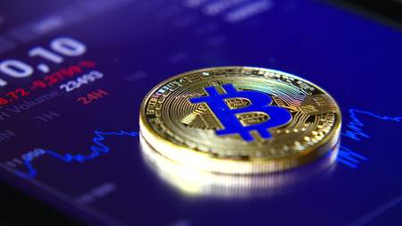 Golden bitcoins on the background of a graphic stock chart. The Concentration of the Crypto-Currency of Virtual Money Stockfoto