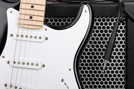 guitar amplifier: Guitar with amplifier and audio cord with jack closeup Stock Photo