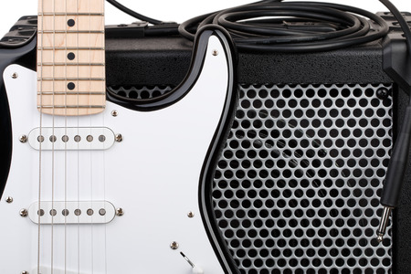 blues music: Guitar with amplifier and audio cord with jack closeup isolated on white background Stock Photo