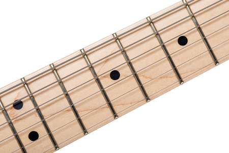 frets: Empty wooden maple fingerboard of classic shaped electric guitar closeup isolated on white background with clipping path. Free frets and strings as improvisation concept Stock Photo