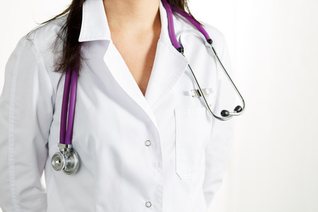 therapeutist: Medicine female therapeutist doctors body standing half-turn with hands crossed behind back on white background. Physician ready to receive patient and help. Medical concept.