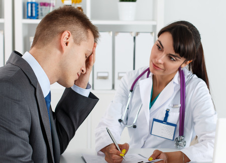 concerned: Concerned beautiful female medicine doctor listening carefully patient complaints. Medical care or insurance concept. Physician ready to examine patient and help. Partnership trust and ethics concept