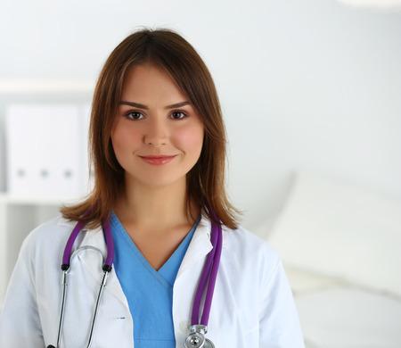 therapeutics: Beautiful smiling female therapeutics medicine doctor in ward looking in camera.