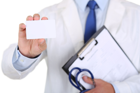 contact: Male medicine doctor hand holding blank calling card.