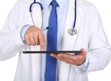 information equipment: Male medicine doctor holding digital tablet pc and pointing it with finger. Medical equipment, modern technology and communication concept. Therapeutist using portable computer searching information Stock Photo