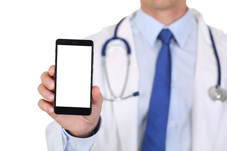 diagnosing: Male medicine doctor holding mobile phone and showing it to camera isolated.