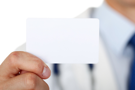 calling card: Male medicine doctor hand holding blank calling card.
