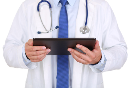 information equipment: Male medicine doctor holding black digital tablet pc. Medical equipment, modern technology and communication concept. Therapeutist using portable computer searching information