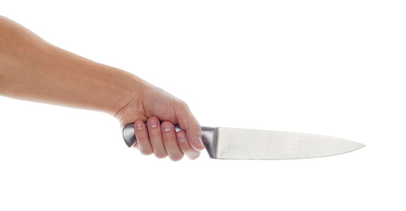 social problems: Male hand holding big silver kitchen knife closeup isolated on white background. Man threaten somebody with knife or trying to cook dinner. Domestic violence and social problems concept