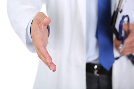 medical cure: Male medicine doctor offering hand to shake closeup isolated on white background. Greeting and welcoming gesture. Medical cure and tests advertisement concept. Physician ready to examine patient