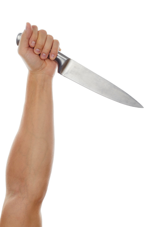 threaten: Male hand holding big silver kitchen knife closeup isolated on white background. Man threaten somebody with knife or trying to cook dinner. Domestic violence and social problems concept
