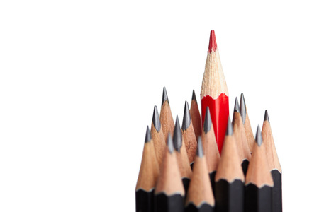 Red pencil standing out from crowd of plenty identical black fellows on white background.