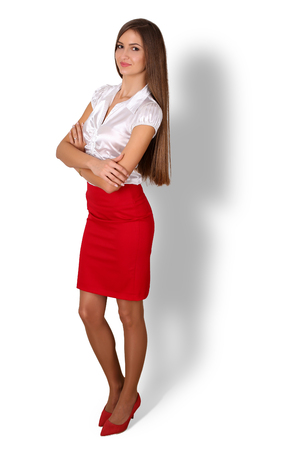 financier: Beautiful smiling young brunette businesswoman with long hair standing full length portrait isolated on white background with shadow. Business success, education, banker or financier concept