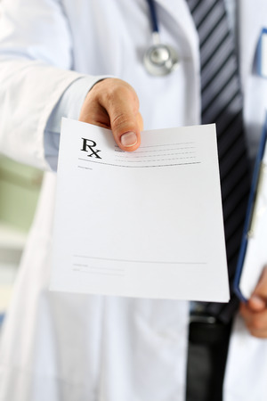 legal pad: Male medicine doctor hand hold clipboard pad and give prescription to patient closeup. Panacea and life save, prescribe treatment, legal drug store, contraception concept. Empty form ready to be used