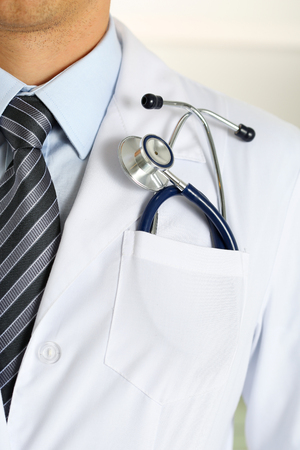 therapeutist: Male medicine therapeutist doctor chest with stethoscope in pocket closeup. Medical tools and instruments shop, physical and disease prevention, patient examination, 911, healthy lifestyle concept Stock Photo