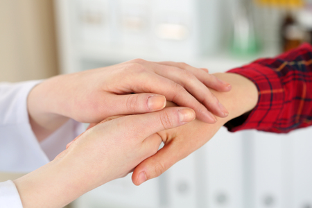 incurable: Woman doctor hands holding female child patient hand. Partnership, medical ethics, patient cheering, news lessening, physician make round, physical, examination, 911, healthy lifestyle concept