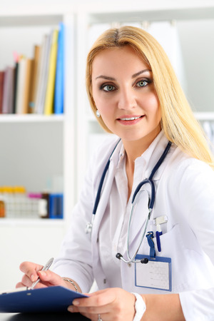 prescribe: Beautiful smiling female doctor hold clipboard pad writing something. Physical, exam, er, disease prevention, ward round, patient visit check, 911, prescribe remedy, healthy lifestyle concept