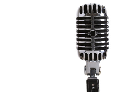 mics: Silver old fashioned stage microphone closeup isolated on white backgroung. Karaoke, vocal learning, music shop or radio concept. Retro style mic ready to rock
